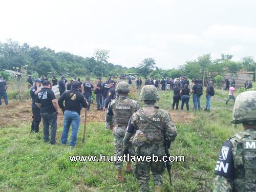 Restituyen tierras invadidas en Huixtla